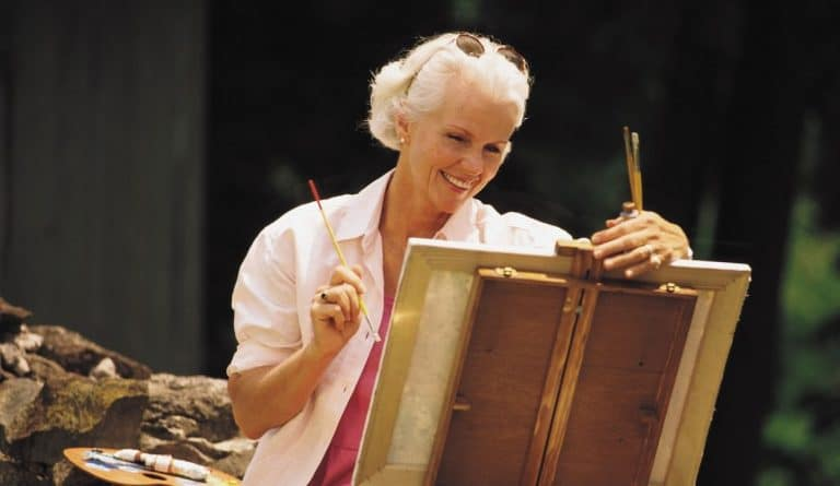 woman smiling artist painting