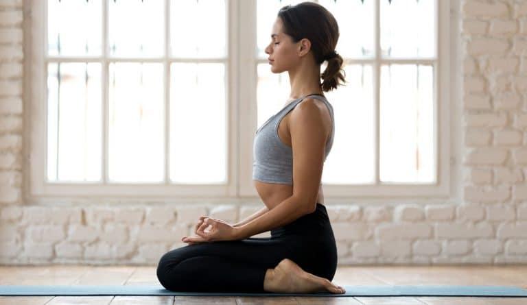 woman yoga position on knees